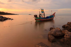 Fisherman Boat with sunset Stock Photos