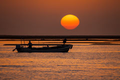Fisherman boat at sunset Stock Photography
