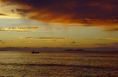 Fisherman boat at sunset Royalty Free Stock Image