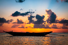 Fisherman boat with sunset scene in koh phangan. Royalty Free Stock Images