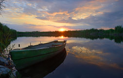 Fisherman boat at sunset time Royalty Free Stock Images