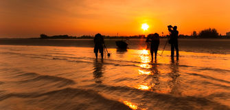 A fisherman boat and three photography at the beach. image might Royalty Free Stock Photography