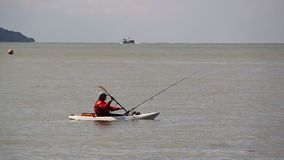 Fisherman in boat. Video footage of a fisherman in a small rowing boat on the kent coast of whitstable stock footage