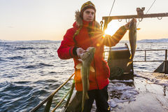 Fisherman on boat with in winter Royalty Free Stock Photos