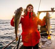 Fisherman on boat with in winter Stock Photo