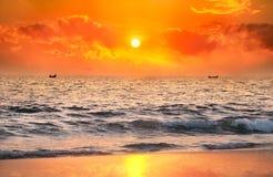 Fisherman boats catching fish at sunset Royalty Free Stock Photography