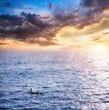 Fisherman boats catching fish at sunset Stock Photo