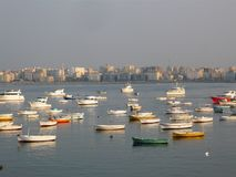 Fisherman boats on city view royalty free stock photography