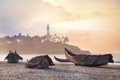 Fisherman boats in India. Fisherman boats on the beach in the morning at lighthouse background in Kovalam, Kerala, India royalty free stock photo