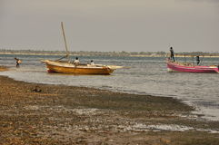 Fisherman with boats at shore Stock Photography