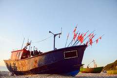 Fisherman boats at sunrise time on the beach Royalty Free Stock Image