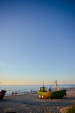 Fisherman boats at sunrise time on the beach Royalty Free Stock Images