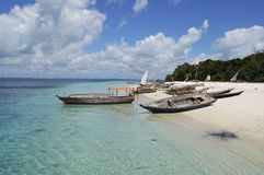 Fisherman boats on a tropical beach Stock Images