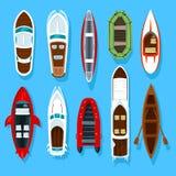 Fisherman boats and wooden sailboat with paddles Royalty Free Stock Photos