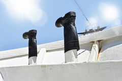 Fisherman boots put to dry on the deck of boat in sea fishing wo Stock Images