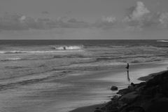 A Fisherman In Caloundra In BW. Dawn is the best way to go fishing in the seaside royalty free stock image