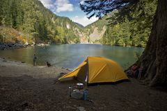 Fisherman camping at a wilderness lake Stock Image