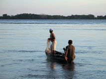 Fisherman in the canoe Stock Image