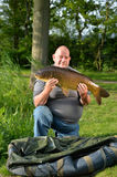 Fisherman with carp Stock Photos
