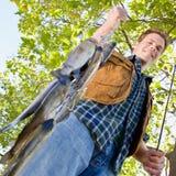 Fisherman carrying fish Stock Photo