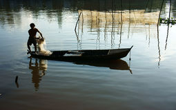 Fisherman cast a net on river Royalty Free Stock Images
