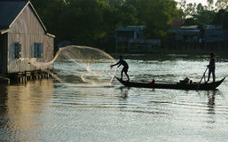 Fisherman cast a net on river Royalty Free Stock Photography
