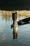 Fisherman cast a net on river Stock Photo