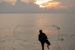 The fisherman cast a net the se. A in the morning, at sunrise, Songkhla province, Thailand country royalty free stock photography