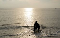 The fisherman cast a net the se. A in the morning, at sunrise, Songkhla province, Thailand country stock image
