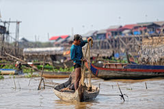 Fisherman casting net, Tonle Sap, Cambodia Stock Photo