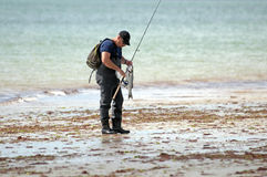 Fisherman with a catch Royalty Free Stock Photos