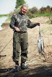 Fisherman with the catch Royalty Free Stock Photo