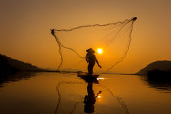 Fisherman catch fish in the morning. Stock Image