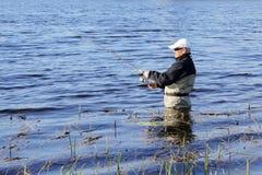 Fisherman catch a pike Stock Photo