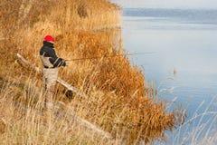 Fisherman catch a pike Stock Image