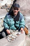 Fisherman and catch trout Stock Photo