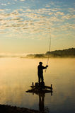 Fisherman. A fisherman catches fish in the morning Stock Photography