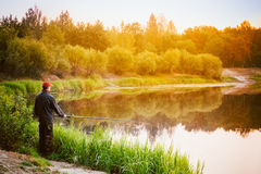 Fisherman Catches Of Fish On River Royalty Free Stock Images