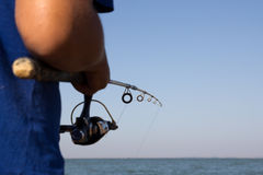 Fisherman catches a fish Stock Photo