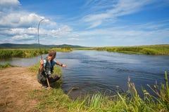 Fisherman catches of salmon Royalty Free Stock Photos