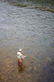 Fisherman catches of salmon Stock Images