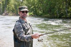 Fisherman catches of salmon Stock Photo