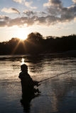 Fisherman catches of salmon at sunset Stock Image