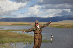 Fisherman  catching fish Stock Photos