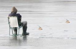 Fisherman catching a fish. Stock Photos