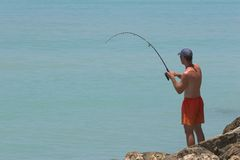 Fisherman catching fish Royalty Free Stock Photos