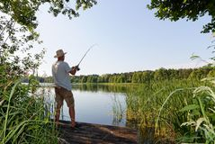 Fisherman. Catching the fish durring sunny day Royalty Free Stock Image