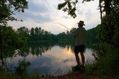 Fisherman. Catching the fish during sunset Stock Image