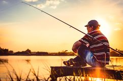 Fisherman caught fish. Caucasian man catch fish on lake. Angler on river fishing. fishing rod lake fisherman men sport. Fisherman caught fish. Caucasian man royalty free stock images