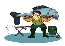 Fisherman caught the fish. Fisherman holds on the shoulders of the fish that were caught Stock Photo